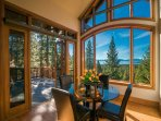 Access the back patio through the breakfast nook for fresh mountain air and sweeping views.
