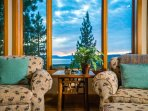 Relax in the lounge chairs just outside of the living area, in a corner with beautiful views of the lake.