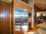 An oversized refrigerator in the kitchen adds even more convenience to this home.
