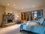 The Master Bedroom has its own fireplace at the foot of the king-size bed.