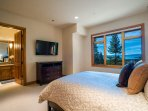 Guest Bedroom 2 has its own wall-mounted flat-screen TV and a private ensuite bathroom.