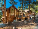 The pine needles and granite stones perfectly accentuate the home's luxury mountain design.