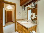 A third guest bathroom features the same elegant design found throughout the home.