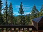 From the back deck, look out over the trees and to the sparkling lake below.