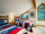 The twin room has beautiful views across the tree tops, and includes two twin beds.