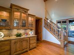 A few steps away from the dining room is a grand display case set next to the third-floor staircase.