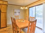 Gather around the 6 person dining table to savor meals.