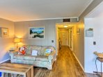 The well-appointed space features hardwood floors and nautical decor.
