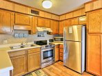 Utilize the stainless steel appliances and ample counter space for your culinary creations.