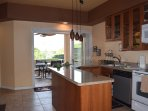 Gourmet Kitchen and Dining Area Open Out to Lanai.