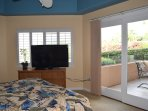 Master Bedroom with King Bed, Ocean View and Flat Screen TV. Open Out to Lanai.