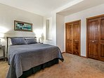 Bedroom 4, located on the lower level, behind den/wet bar, is furnished with a queen bed and en suite bath.