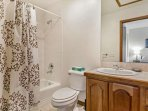 Bedroom 4 en suite bath with single vanity.