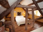 King-size bedroom with single bed