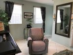 Large Unit-another view of Family room showing comfortable recliner and beautiful large mirror