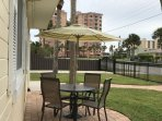 Small unit#1 private Outdoor dining table-View of Condo Building Beach access path to ocean by it