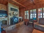 Warm up by the wood-burning fireplace in the living room while you tune into the flat-screen TV.