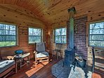 Bring a book out to the garden house for a relaxing afternoon by the wood-burning stove.