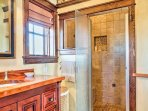 This spacious en-suite bathroom boasts a large walk-in shower.