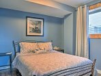 This basement bedroom is decorated with soothing tones of blue and gray.