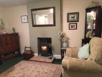 Cosy lounge with log burning stove, free wifi, chromecast and central heating throughout