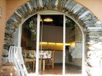 Arched glass door of the kitchen leading to the garden & next to boat entrance.