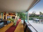 the sliding doors open up wide to create a wonderful indoor-outdoor flow