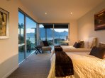 bedroom 3 with lake views and patio access, can have 2x singles or 1x king