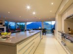 fully-equipped modern kitchen with coffee machine
