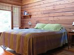 Master bedroom with queen size bed, ensuite bathroom and small balcony overlooking the property