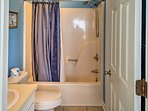 The master bathroom features a shower/tub combo.