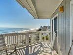 Admire unobstructed ocean views on the private balcony of this 2-bedroom, 2-bathroom vacation rental condo.