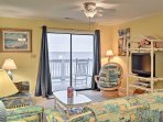 Watch your favorite TV shows in the cozy living room or simply admire the sprawling ocean.