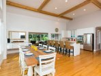 High wood beam ceilings and large windows make the open-concept kitchen feel even more spacious.