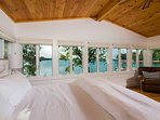 You'll have incredible lakefront views from every corner of the master bedroom.