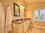 The second master en-suite features a his-and-hers vanity and walk-in shower.