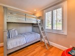Tuck the kiddos into bed on the twin-over-twin bunk bed.