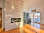 The dining area includes added luxuries of a gas fireplace and flat-screen cable TV.