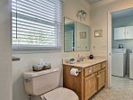 Be squeaky clean with a walk-in shower, single vanity, and laundry machines.