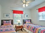 Let the kids rest up inside the second bedroom on 2 cozy twin beds.