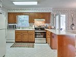 The kitchen is fully equipped with updated appliances and culinary amenities.