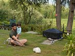 Guest & his daughter, near the portable firepit, trying to coax Bun Rab to eat out of his hand