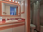 Freshen up in the full bathroom, offering a tub/shower combo and mirrored vanity.