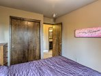 The second bedroom offers a cozy queen-sized bed.