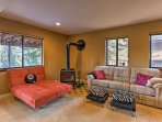 The first floor living room features plush seating and a wood-burning stove.