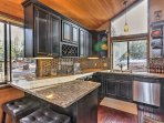 The pristine kitchen is fully equipped with stainless steel appliances.