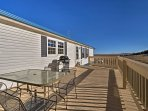 Enjoy the spacious deck that overlooks the 3 acre property.