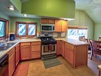 The spacious kitchen makes it easy to prepare home-cooked meals throughout your stay.