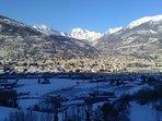 Aosta tinteggiata di bianco