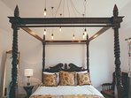 Gorgeous four poster bed in the master bedroom of Amba Barn